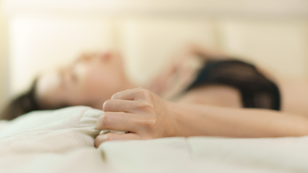 image of a woman in bed