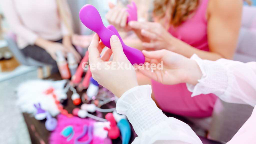 woman's hands holding a vibrator