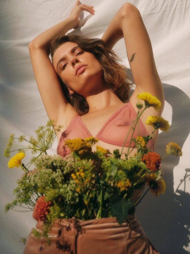 women in pink bra with flowers