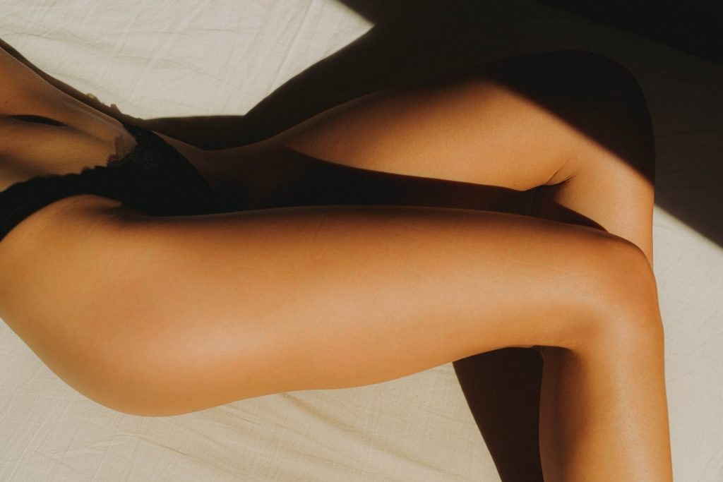 tanned legs with black underwear in bes