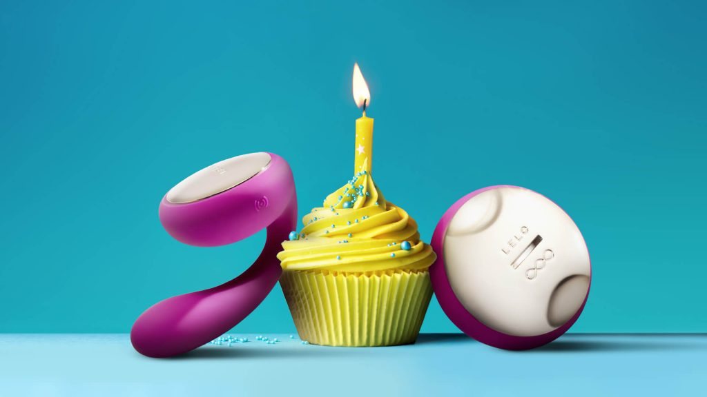 Lelo pink vibrators with yellow cupcake in blue background